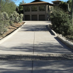 Exposed aggregate driveway with stone paver designs